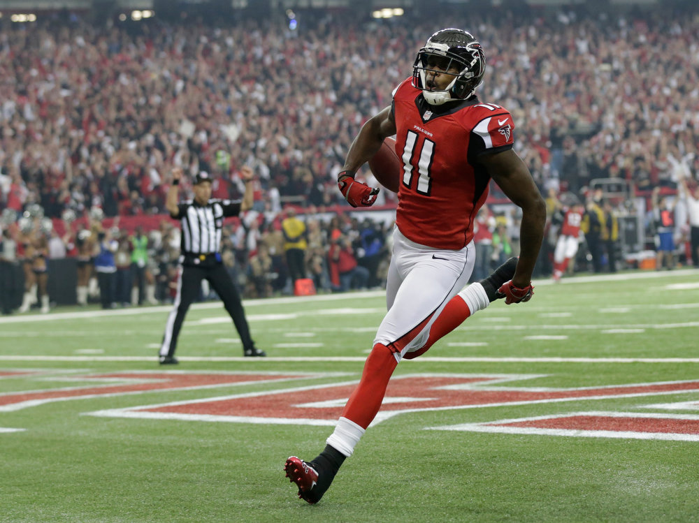 Description of . Atlanta Falcons\' Julio Jones runs into the end zone after catching a 46-yard touchdown pass during the first half of the NFL football NFC Championship game against the San Francisco 49ers Sunday, Jan. 20, 2013, in Atlanta. (AP Photo/Dave Martin)