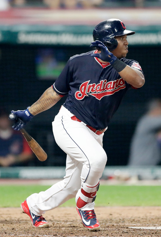 . Cleveland Indians\' Jose Ramirez hits a single in the fifth inning of a baseball game against the Minnesota Twins, Wednesday, Aug. 29, 2018, in Cleveland. (AP Photo/Tony Dejak)