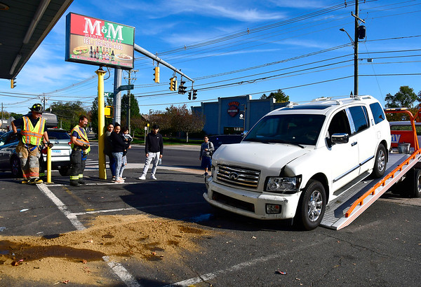 10/15/2019 Mike Orazzi | StaffrThe driver of an Infiniti QX56 that crashed into the M & M Mini Mart at the corner of Jerome Avenue and Route 6 was transported from the scene on mid-afternoon in Bristol on Tuesday. The market sustained enough damage to be close and the adjacent Corner Pizza Restaurant was able to remain open for business.