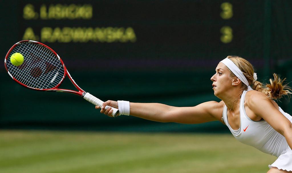 . Sabine Lisicki of Germany plays a return to Agnieszka Radwanska of Poland Women\'s singles semifinal match at the All England Lawn Tennis Championships in Wimbledon, London, Thursday, July 4, 2013. (AP Photo/Kirsty Wigglesworth)