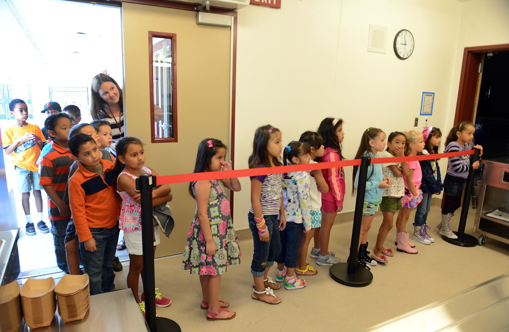 . Second grade teacher Kelly McCoy gives her students a tour of their new campus on the first day of school, including the lunchroom at Mary Casey Black Elementary School in Brentwood, Calif., on Tuesday, July 30, 2013.  (Susan Tripp Pollard/Bay Area News Group)