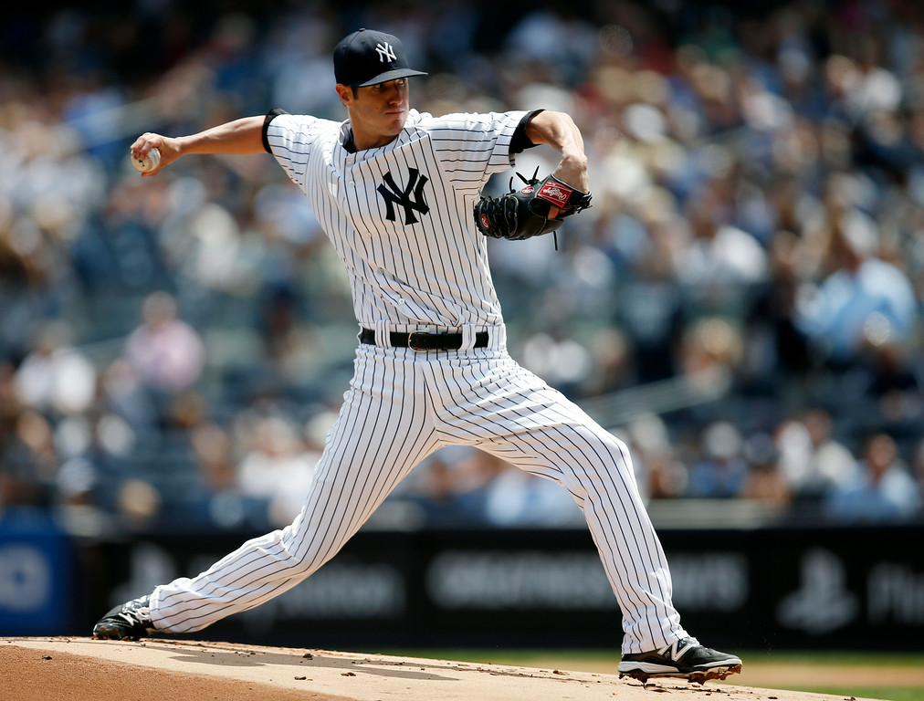 . New York Yankees starting pitcher Shane Greene delivers in the first inning of a baseball game against the Detroit Tigers at Yankee Stadium in New York, Thursday, Aug. 7, 2014.  (AP Photo/Kathy Willens)