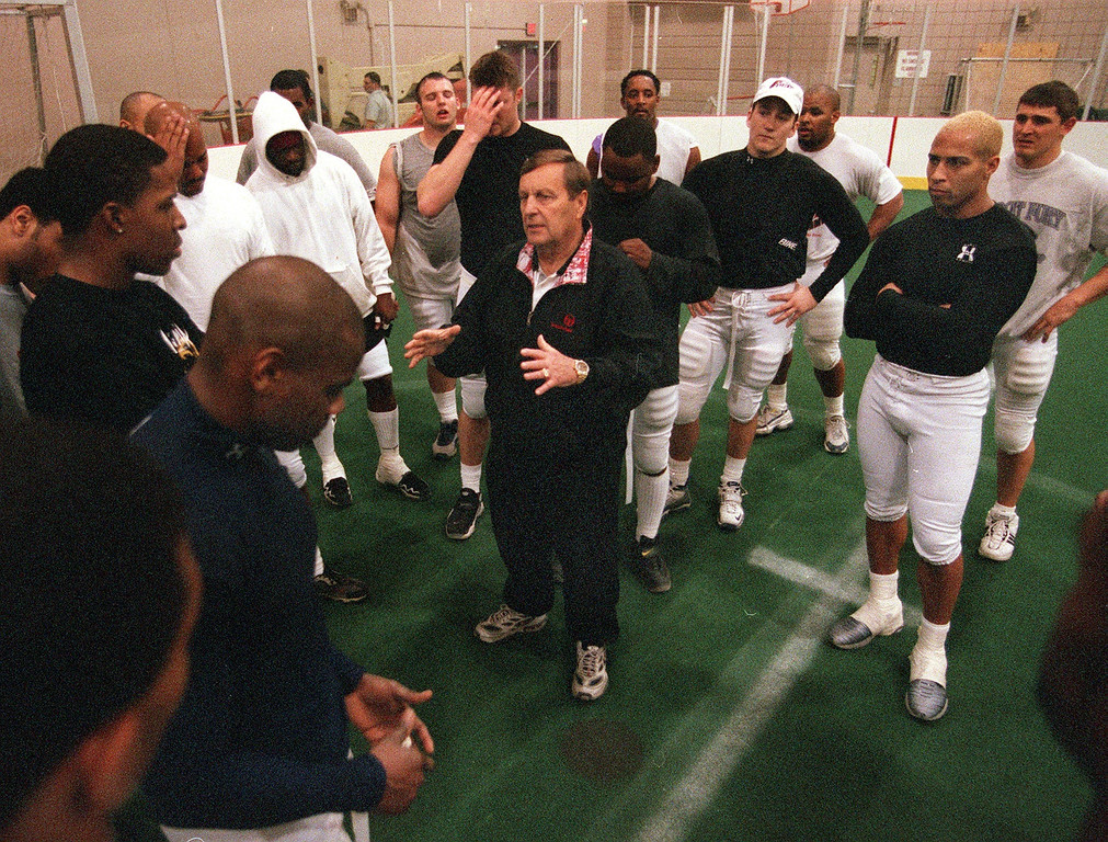 . Detroit Fury head coach Mouse Davis, center, talks to his team after a training camp session at the Troy Sports Center in Troy, MIch., Tuesday, March 20, 2001.  Davis is a former Detroit Lions offensive coordinator.  Listening in, second from right, is Robert Gordon, who is a WR/DB.