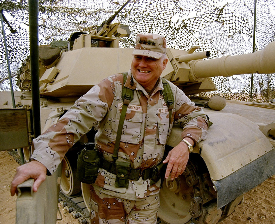. In this Jan. 12, 1991 file photo, Gen. H. Norman Schwarzkopf stands at ease with his tank troops during Operation Desert Storm in Saudi Arabia. Schwarzkopf died Thursday, Dec. 27, 2012 in Tampa, Fla. He was 78.  (AP Photo/Bob Daugherty, File)