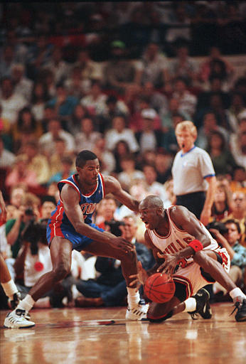 Description of . Chicago Bulls Michael Jordan, right, grabs a loose ball from Detroit Pistons Joe Dumars, left, in the fourth quarter of their Eastern Conference final playoff game 4 in Chicago, Ill., May 29, 1990. (AP Photo/Jim Mone)