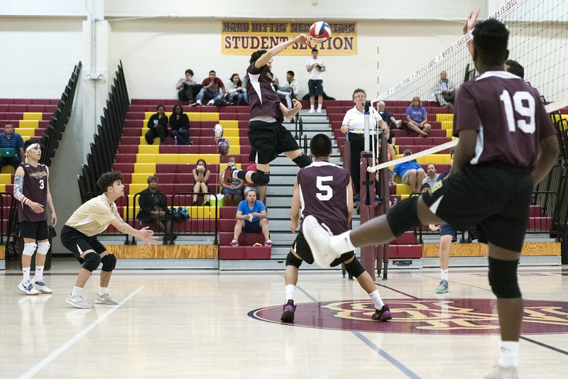 05/20/19  Wesley Bunnell | Staff  New Britain volleyball vs Simsbury on Monday night at New Britain High School.  Bryan Rodriguez (6) goes up high.