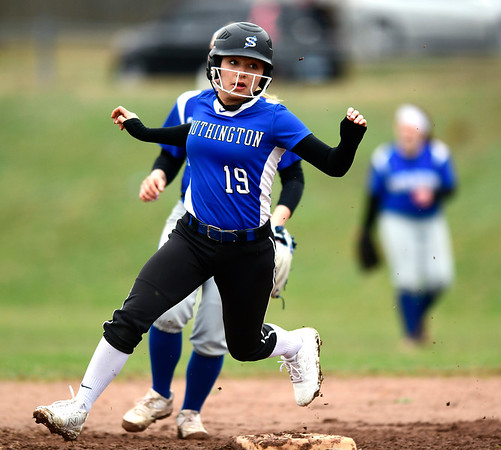 4/9/2019 Mike Orazzi | Staff Southington's Alison Rembish (19) during Tuesday's softball game in Bristol.