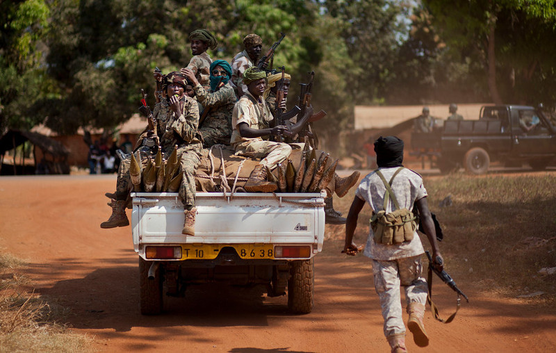 . A soldier runs to jump on a moving truck carrying Chadian soldiers who are fighting to support Central African Republic president Francois Bozize, in Damara, about 70km (44 miles) north of the capital Bangui, Central African Republic Wednesday, Jan. 2, 2013. After troops under Bozize seized the capital in 2003 amid volleys of machine-gun and mortar fire, he dissolved the constitution and parliament, and now a decade later it is Bozize himself who could be ousted from power with rebels having seized more than half the country and made their way to the doorstep of the capital in less than a month. (AP Photo/Ben Curtis)
