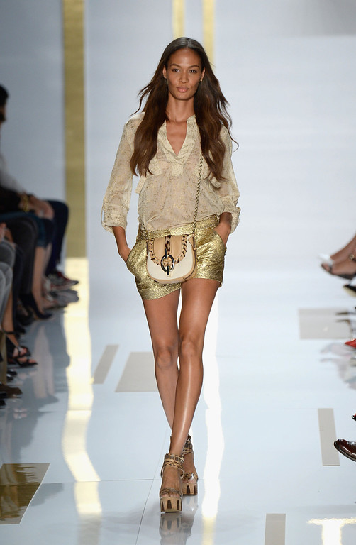 . Model Joan Smalls walks the runway at the Diane Von Furstenberg fashion show during Mercedes-Benz Fashion Week Spring 2014 at The Theatre at Lincoln Center on September 8, 2013 in New York City.  (Photo by Frazer Harrison/Getty Images for Mercedes-Benz Fashion Week Spring 2014)