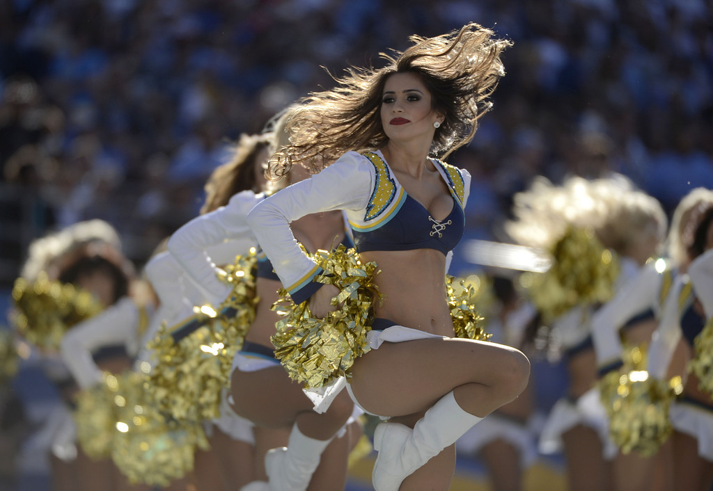 . The San Diego Chargers cheerleaders dance on the field during the game against the Kansas City Chiefs on December 29, 2013 at Qualcomm Stadium in San Diego, California. (Photo by Donald Miralle/Getty Images)