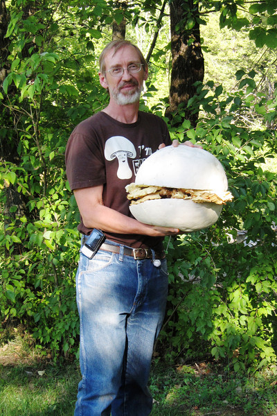 Glen shows off his mushroom sandwich. A Giant Puffball bun with a big slab of Chicken of the Woods down the middle.