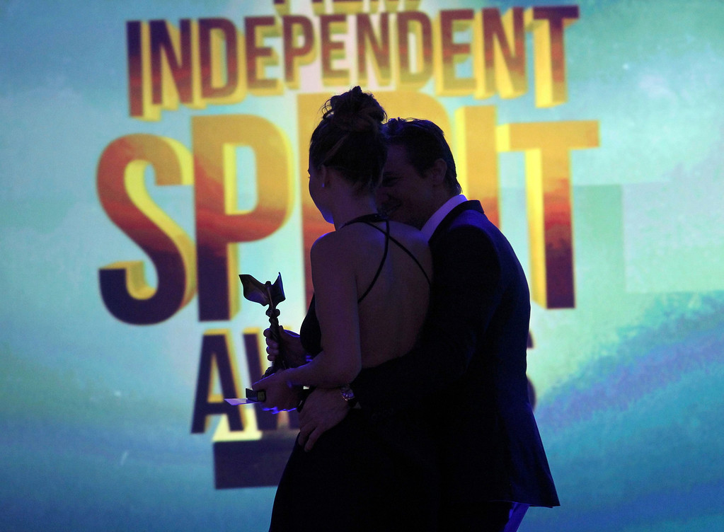 """. Presenter Jeremy Renner and actress Jennifer Lawrence walk off the stage after she accepted the award for best female lead for \""""Silver Linings Playbook\'\' at the 2013 Film Independent Spirit Awards in Santa Monica, California February 23, 2013.   REUTERS/David McNew"""