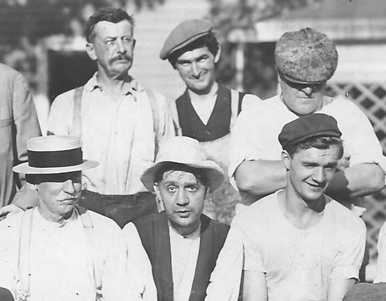 This motley group of gentlemen is rumored to have been known as the Self-Master Six as seen in this 1910's photo taken behind the main house of the Self Master Colony. Can you guess who might be the mastermind of the group?