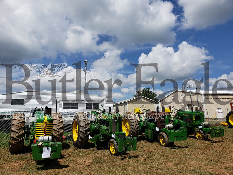 The Filges family competes in tractor pull competitions with their four, vintage John Deere G tractors. -Tanner Cole