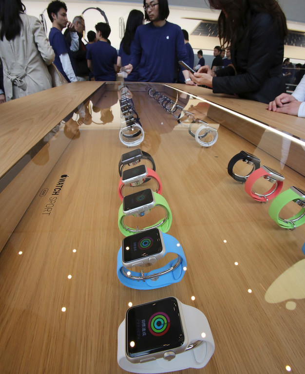 . Models of Apple Watch are displayed in a glass case at an Apple Store in Tokyo as Apple Watch made its debut Friday, April 10, 2015. Customers were invited to try them on in stores and order them online. (AP Photo/Koji Sasahara)