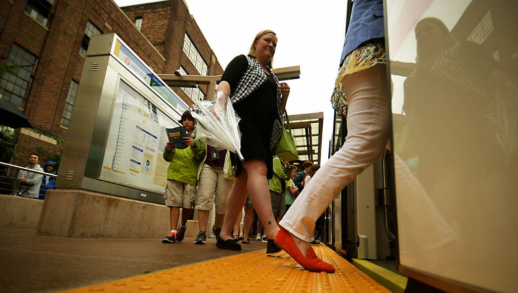 . Passengers board a west bound train from Union Station during the Metro Transit Green Line Grand Opening in St. Paul.(Pioneer Press: John Autey)