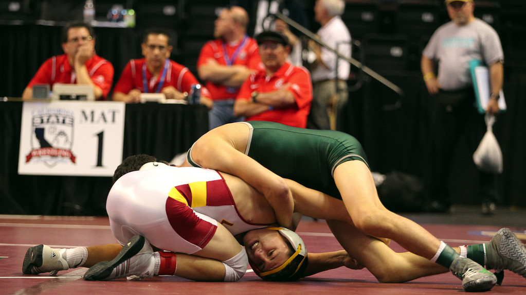 . Liberty\'s Austin Solari, left, wrestles Poway\'s Ralphy Tovar in a 132-pound fifth place match during the California Interscholastic Federation wrestling championships in Bakersfield, Calif., on Saturday, March 2, 2013. Tovar would go onto win the match. (Anda Chu/Staff)