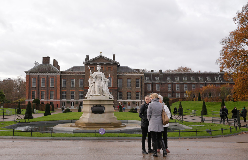 . People stand outside Kensington Palace in London, Monday Nov. 27, 2017. Palace officials announced Monday that Prince Harry and Meghan Markle are engaged, and will marry in the spring. (AP Photo/Alastair Grant)