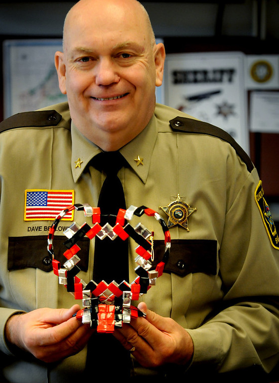 . Dakota County Sheriff Dave Bellows shows off a picture frame made by an inmates at the Dakota County Jail. (Pioneer Press: Jean Pieri)