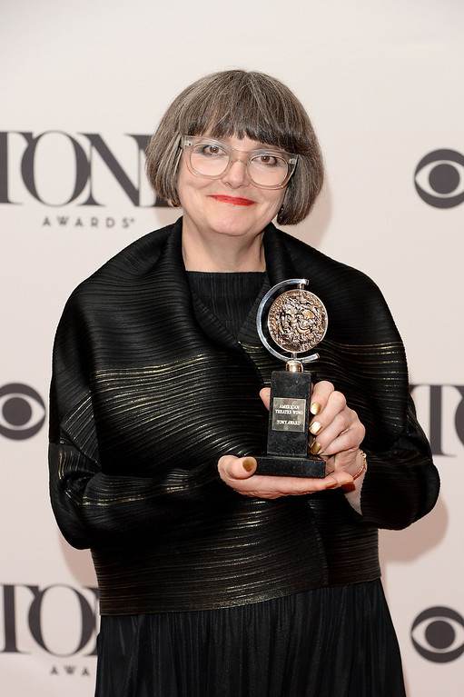 """. Jenny Tiramani, winner of the Tony Award for Best Costume Design of a Play for \""""Twelfth Night\""""  poses in the press room during the 68th Annual Tony Awards on June 8, 2014 in New York City.  (Photo by Andrew H. Walker/Getty Images for Tony Awards Productions)"""