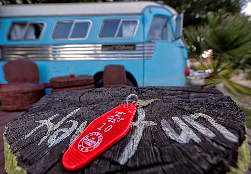 . A retro motel room key to a 1947 Airporter bus sits on a tiki pole at the Shady Dell Trailer Court, Tuesday, April 25, 2017, in Bisbee, Ariz. The Hawaiian themed bus, surrounded by tiki poles, a surf board lounge table and festive lights, is used as a guest room at the trailer lodge in the Southern Arizona historic copper mining town. (AP Photo/Matt York)