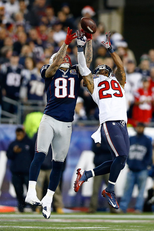 . FOXBORO, MA - DECEMBER 10:  Tight end Aaron Hernandez #81 of the New England Patriots and strong safety Glover Quin #29 of the Houston Texans go up for the ball in the first half at Gillette Stadium on December 10, 2012 in Foxboro, Massachusetts.  (Photo by Jared Wickerham/Getty Images)