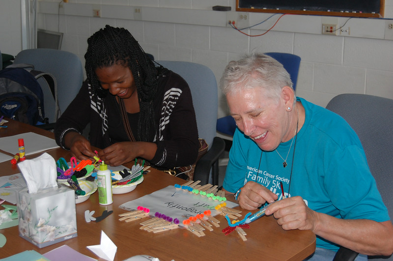 """Even some """"big kids"""" enjoyed the crafts at the Open House - Anita Palmer is making a dragon fly for Center Assistant, Kelly O'Ferrell (THANK YOU!)"""