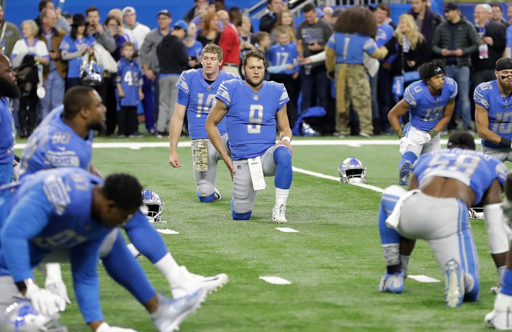 . Detroit Lions quarterback Matthew Stafford (9) stretches during pregame of an NFL football game against the Cleveland Browns, Sunday, Nov. 12, 2017, in Detroit. (AP Photo/Carlos Osorio)