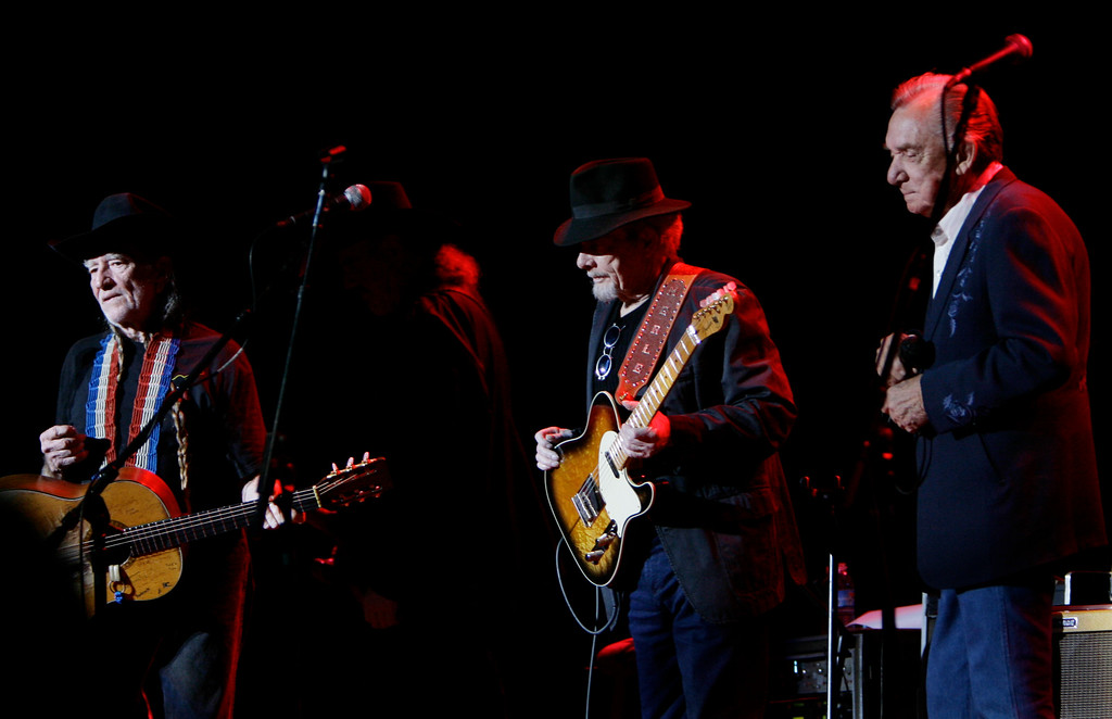 . Willie Nelson, left, Merle Haggard and Ray Price perform during a tour stop at the Aladdin Theater for the Performing Arts in Las Vegas on Saturday, March 10, 2007. (AP Photo/Laura Rauch)