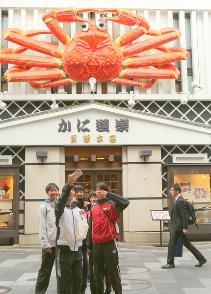 Young boys take a selfie with Lobster