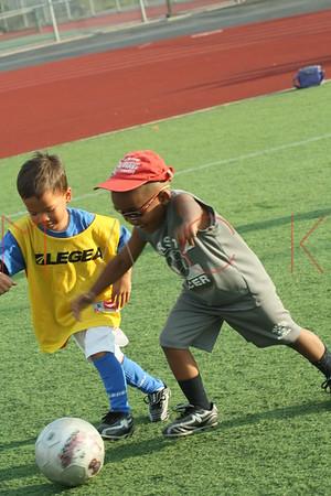 BROOKLYN - JULY 22: Brooklyn Italians Soccer Academy practice at John Dewey High School on Thursday, July 22, 2010 in Brooklyn, NY.