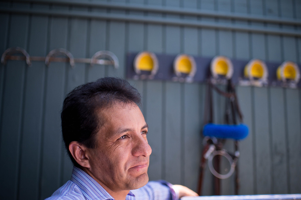 . Jockey Victor Espinoza waits for Triple Crown-winner American Pharoah to return home to Bob Baffert\'s barn at Santa Anita Thursday, June 18, 2015. American Pharoah and Espinoza broke a 37-year Triple Crown drought by winning the Kentucky Derby, Preakness and Belmont Stakes. (Photo by Sarah Reingewirtz/Pasadena Star-News)