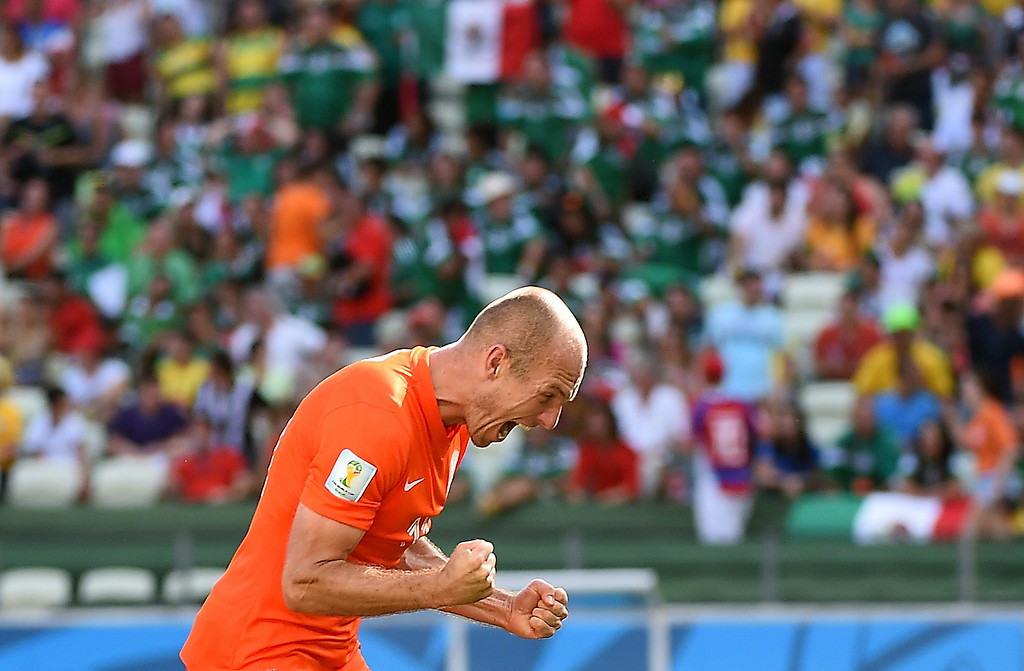 . Netherlands\' forward Arjen Robben reacts after victory in the Round of 16 football match between Netherlands and Mexico at Castelao Stadium in Fortaleza during the 2014 FIFA World Cup on June 29, 2014. AFP PHOTO / EMMANUEL DUNAND