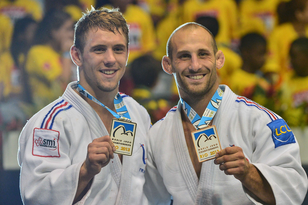 . French gold medallist Loic Pietri (L) and bronze medallist Alain Schmitt, pose on the podium during the medal ceremony for the men\'s -81kg category, during the IJF World Judo Championship, in Rio de Janeiro, Brazil, on August 29, 2013. YASUYOSHI CHIBA/AFP/Getty Images