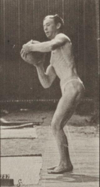 Man in pelvis cloth lifting rock