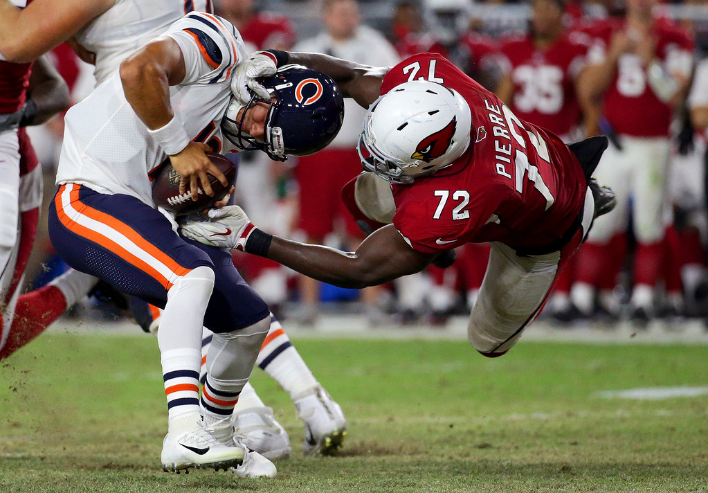 . Chicago Bears quarterback Mitchell Trubisky (10) is sacked by Arizona Cardinals defensive tackle Olsen Pierre (72) during the second half of a preseason NFL football game, Saturday, Aug. 19, 2017, in Glendale, Ariz. (AP Photo/Ralph Freso)