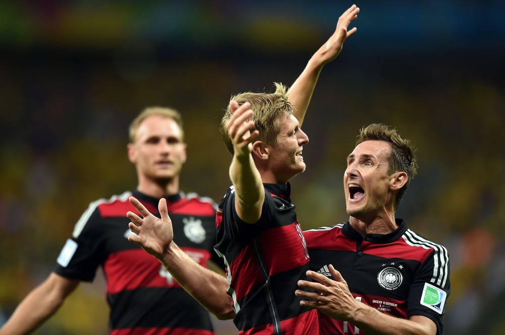 Description of . Germany's midfielder Toni Kroos celebrates after scoring during the semi-final football match between Brazil and Germany at The Mineirao Stadium in Belo Horizonte during the 2014 FIFA World Cup on July 8, 2014. (VANDERLEI ALMEIDA/AFP/Getty Images)