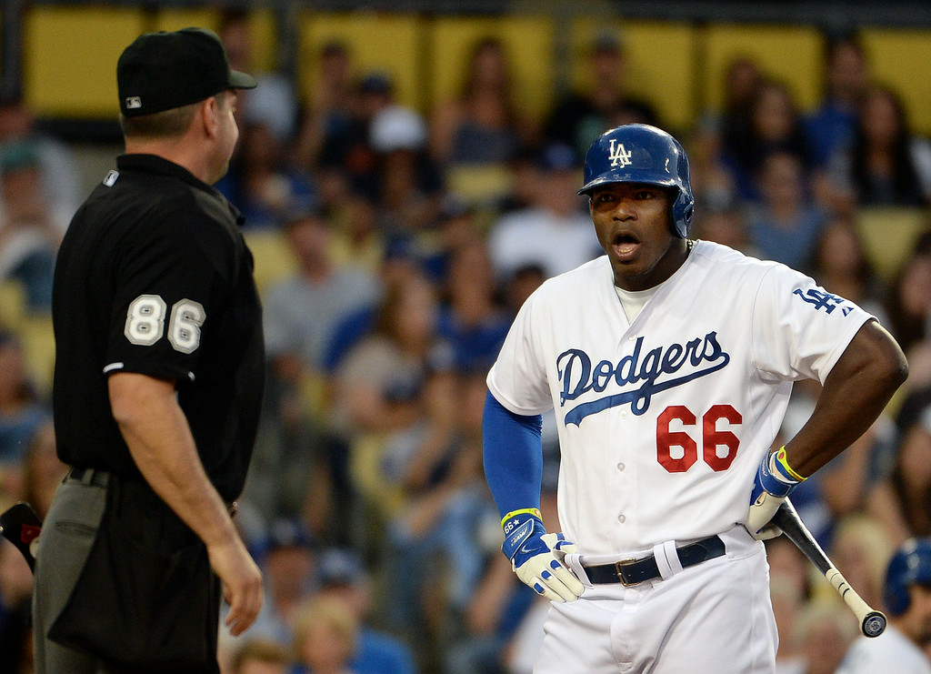 . Los Angeles Dodgers\' Yasiel Puig (66) is ejected from the game by home plate umpire David Rackley (86) after being called out on a third strike pitch in the third inning of a Major league baseball game against the San Diego Padres on Saturday, July 12, 2014 in Los Angeles.   (Keith Birmingham/Pasadena Star-News)