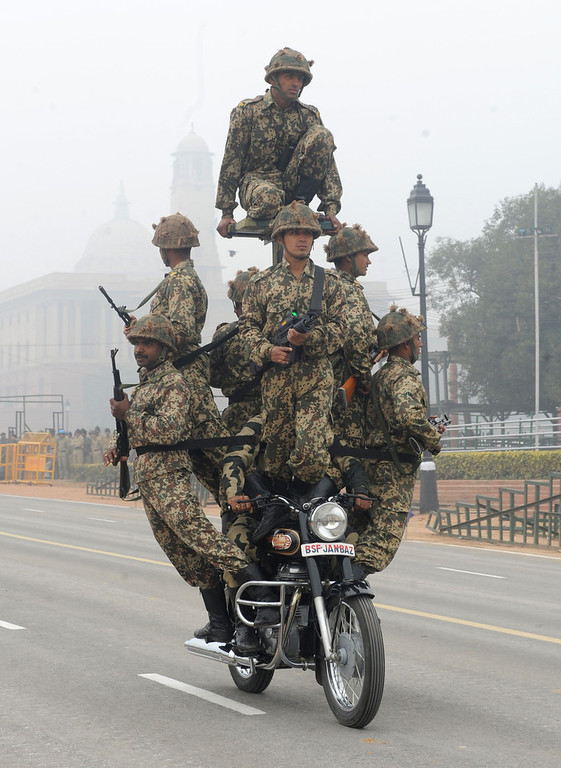 . Indian Border Security Force (BSF) soldiers perform a motorcycle stunt during a rehearsal for India\'s upcoming Republic Day parade in New Delhi on January 20, 2012. The country wide preparations are picking up to celebrate India\'s transition to a Republic on  January 26, 1950.  AFP PHOTO/RAVEENDRAN