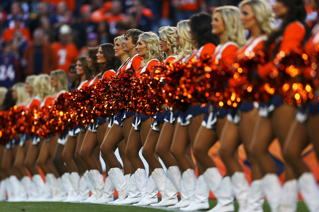 . The Denver Broncos cheerleaders perform against the Oakland Raiders at Sports Authority Field at Mile High on September 23, 2013 in Denver, Colorado.  (Photo by Justin Edmonds/Getty Images)