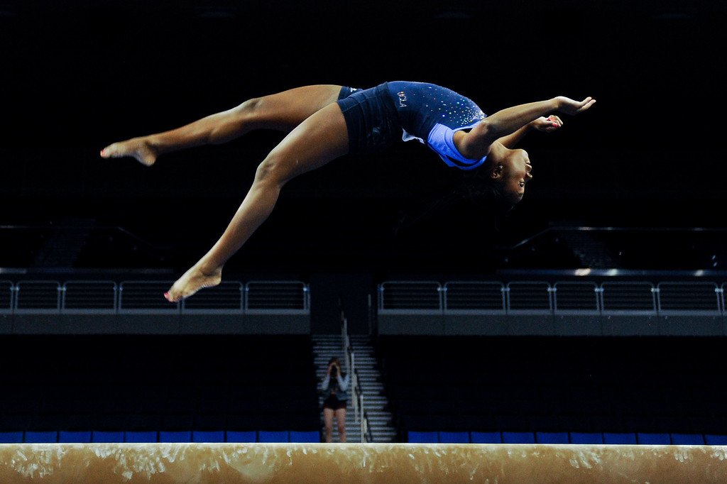 . UCLA\'s Olivia Courtney practices on the beam. (Michael Owen Baker/Staff Photographer)