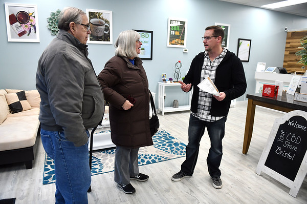 12/5/2019 Mike Orazzi | StaffrYour CBD Store Manager Jeremy Morgan talks about the benefits of CBD oil with Linda and James Konopaske at the Bristol location.