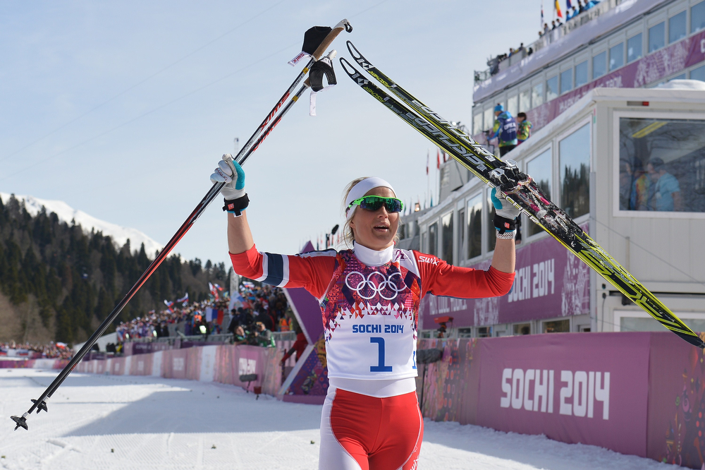 . Silver medalist Norway\'s Therese Johaug celebrates at the finish line in the Women\'s Cross-Country Skiing 30km Mass Start Free at the Laura Cross-Country Ski and Biathlon Center during the Sochi Winter Olympics on February 22, 2014, in Rosa Khutor, near Sochi.  (ALBERTO PIZZOLI/AFP/Getty Images)