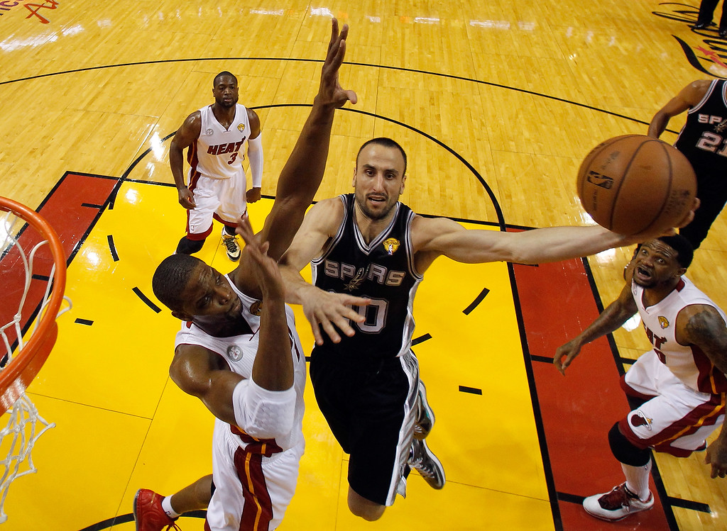 . Manu Ginobili #20 of the San Antonio Spurs goes up for a shot against Chris Bosh #1 of the Miami Heat in the second half during Game One of the 2013 NBA Finals at AmericanAirlines Arena on June 6, 2013 in Miami, Florida.  (Photo by Mike Segar/Pool/Getty Images)