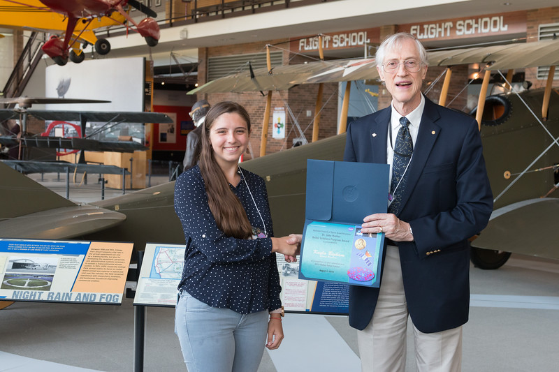 "Kayla Bigham with John Mather, in front of Curtiss Jenny JN-4 -- An award luncheon, ""Dr. John Mather Nobel Scholars Program Award"", as part of the National Space Grant Foundation. College Park Aviation Museum, College Park, MD, August 2, 2019."