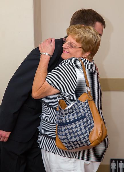 Groom getting hug from guest.jpg