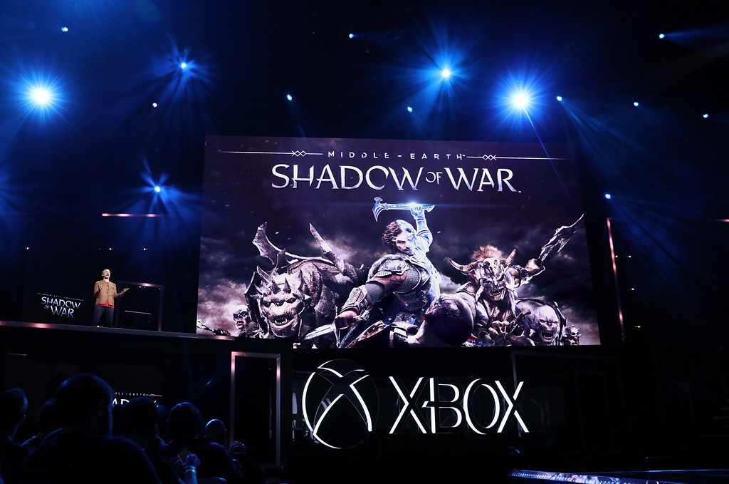 ". IMAGE DISTRIBUTED FOR MICROSOFT - Michael de Plater, Vice President of Creative, Monolith Productions, demos ""Middle-earth: Shadow of War\"" at the Xbox E3 2017 Briefing on Sunday, June 11, 2017 in Los Angeles. (Photo by Matt Sayles/Invision for Microsoft/AP Images)"