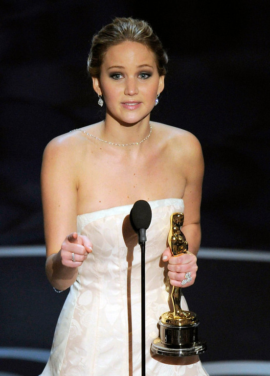". Jennifer Lawrence accepts the award for best actress in a leading role for ""Silver Linings Playbook\"" during the Oscars at the Dolby Theatre on Sunday Feb. 24, 2013, in Los Angeles.  (Photo by Chris Pizzello/Invision/AP)"