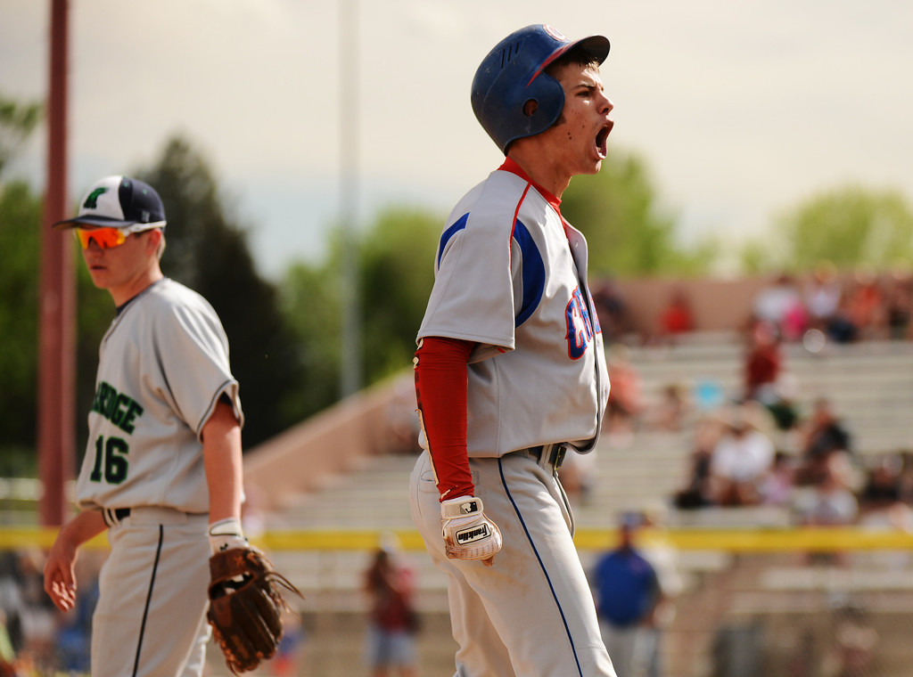 . DENVER, CO. - MAY 24 :Lane Milligan of Cherry Creek High School (12) shows emotion after hitting triple during semifinal round of 5A State Championships baseball game against ThunderRidge High School at All City Field. Denver, Colorado. May 24, 2013. ThunderRidge won 5-1. (Photo By Hyoung Chang/The Denver Post)