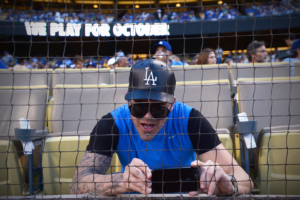 . A fan films the field before Los Angeles Dodgers play the Atlanta Braves during game 4 of the NLDS at Dodger Stadium Monday, October 7, 2013. (Photo by Sarah Reingewirtz/Los Angeles Daily News)